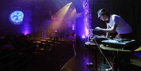 """A DJ performs prior to Mosaic Church's pastor Erwin McManus' sermon at The Mayan night club, in Los Angeles. Mosaic, a 3,000-member megachurch, is one of six finalists in the Doritos' """"Crash the Super Bowl"""" challenge with a lighthearted spoof that plays off the resurrection of Jesus Christ."""