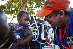 Hugh McCulloch dotes on a Haitian girl in Leogane, where he and fellow Edge Outreach volunteers have installed water purifiers.