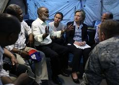 Secretary of State Hillary Clinton meets with Haitian President Rene Preval, third from left, in Port-au-Prince on Jan. 16 to discuss conditions in the country following the deadly earthquake.