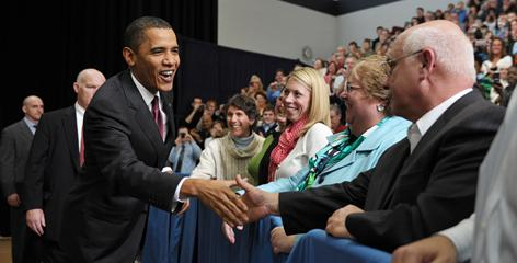 President Obama greets guests at a town hall meeting Tuesday in Nashua, N.H.