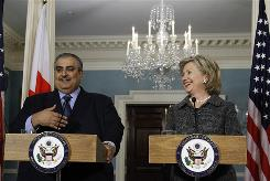 Secretary of State Hillary Clinton and Bahraini Foreign Minister Sheik Khalid bin Ahmed al-Khalifa meet reporters at the State Department in Washington on Wednesday. Clinton will not swap Iranian citizens held in the U.S. for the American hikers in Iran.