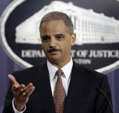 Attorney General Eric Holder gestures during a news conference at the Justice Department in Washington.