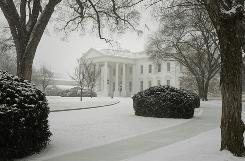 Snow falls upon the White House in Washington on Saturday. Another storm is forecast to dump more than a foot of snow on the Mid-Atlantic this weekend.