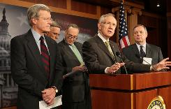 Senate Majority Leader Harry Reid, center, flanked by Sen. Max Baucus, Charles Schumer, Dick Durbin and Byron Dorgan discuss Thursday how President Obama's 2011 budget proposal will create jobs.