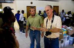 Cape Coral pilot David Beauvois tells Cape Christian Fellowship members on Saturday that the supplies and goods they flew to Haiti might not reach an orphange the church supports because of a customs holdup in Cap Haitien. At left is co-pilot Sean Sanders.