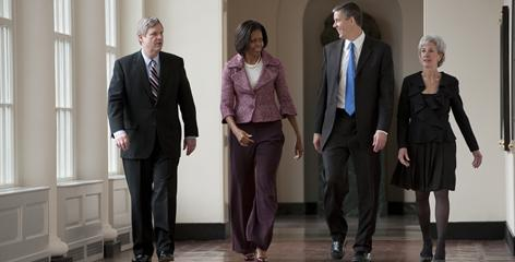 First lady Michelle Obama walks through the White House east colonnade with Agriculture Secretary Tom Vilsack, left, Education Secretary Arne Duncan, second from right, and Health and Human Services Secretary Kathleen Sebelius, as they meet regarding the childhood obesity initiative.