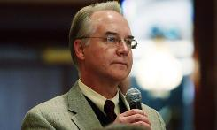 Rep. Tom Price, R-Ga., asks President Obama, not pictured, a question during a House Republican retreat in Baltimore on Jan. 29.