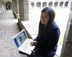 Daisy Mateo pulls up a website with a Spanish translation on her laptop at Bryn Mawr College in Bryn Mawr, Pa.