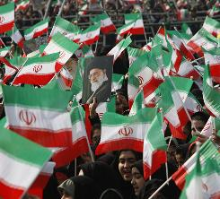 Demonstrators wave Iranian flags, as a picture of supreme leader Ayatollah Ali Khamenei, is held at center, during a rally commemorating the anniversary of the 1979 Islamic Revolution, at the Azadi (freedom) Square in Tehran on Thursday.