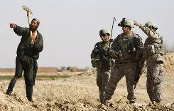 U.S. soldiers talk to a villager west of Lashkar Gah in Helmand province, Afghanistan, on Thursday. The troops will support a planned Marine offensive against the Taliban in the Marjah area.