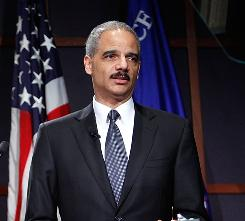 Attorney General Eric Holder said he still expects Khalid Sheikh Mohammed to be tried in a federal civilian court, but he conceded it's possible that won't happen.
