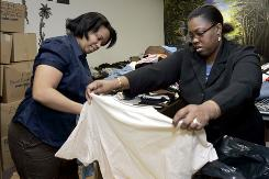 JoAnne Thompson, left, a volunteer, and Daniela Ducasse, program director at Konbit Neg Lakay community center in Spring Valley, N.Y., sort through donated items on Jan. 22 for earthquake relief in Haiti.