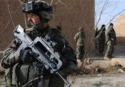 A French soldier patrols the Afghan village of Qari Saheb on Monday. At least 27 insurgents were reported killed.
