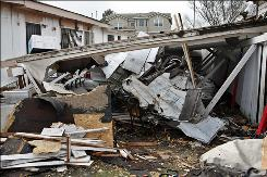 A small plane crashed into a house in East Palo Alto, Calif., killing three passengers.