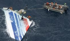 In this June 8, 2009, file photo released by Brazil's Air Force, sailors recover debris from the missing Air France Flight 447 in the Atlantic Ocean.