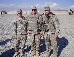 "Sgt. 1st Class Elbert ""Rusty"" Coleman, center, returned to the Army to serve with his sons, Spc. Sean Coleman, right, and 1st Lt. Myles Coleman. ""It's awesome to see my Dad back on active duty,"" Myles Coleman said."