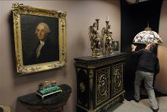 A portrait of George Washington hangs on the wall of Cottone Auctions in Geneseo, N.Y. It is expected to fetch $200,000 to $300,000 when auctioned on March 27.