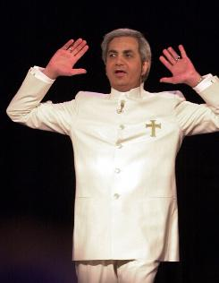 Benny Hinn during a service at the Blaisdell Concert Hall in Honolulu.