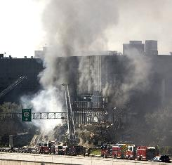 Smoke billows from a seven-story building after a small private plane crashed into the building Thursday in Austin.