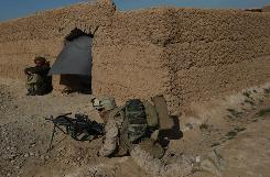 A U.S. Marine from 3rd Battalion, 6th Marine Regiment takes a defensive position while on patrol in Marjah in Afghanistan's Helmand province on Friday.