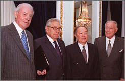 China's now-former ambassador to the U.S. Li Daoyu, second from right, meets with then-former U.S. secretaries of state, from left to right, Cyrus Vance, Henry Kissinger and Alexander Haig.