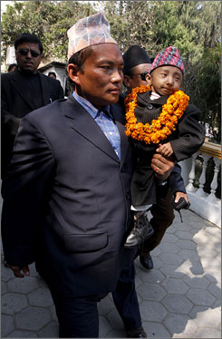 Khagendra Thapa Magar, who is 22 inches tall, is traveling to Europe to campaign for the Guinness World Record title.