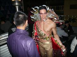This year's Mr. Gay Hong Kong, Rick Twombley, unveils his costume for the Worldwide Mr. Gay pageant earlier this month.