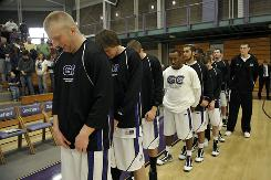 Basketball players at Goshen College say a prayer before the tipoff of their game with Spring Arbor University Feb. 20 in Goshen, Ind.