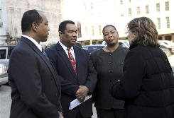 Dr. Romell Madison, left, Lance Madison and Jackie Madison Brown talk to attorney Mary Howell in New Orleans on Wednesday after Michael Lohman pleaded guilty to conspiring with fellow NOPD officers to obstruct justice by covering up a police-involved shooting that killed their brother, Ronald Madison, during the aftermath of Hurricane Katrina in 2005.