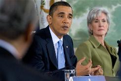 President Obama, seated with Health Secretary Kathleen Sebelius, speaks at a bipartisan meeting Thursday with members of Congress to discuss health care legislation at Blair House.
