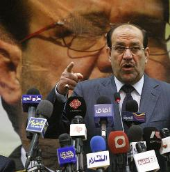Iraqi Prime Minister Nouri al-Maliki addresses a campaign rally in Baghdad on Friday.