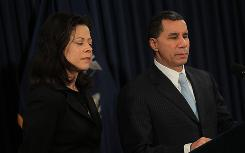 New York Gov. David Paterson stands with his wife, Michelle Paige Paterson, on Friday in New York City. Paterson announced that he will not run for another term as New York's governor.