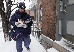Letter carrier Bob Wimmers delivers mail in Covington, Ky., Jan. 7. Postmaster General John Potter, who heads the U.S. Postal Service, said he'll request a five-day schedule by the end of this month.