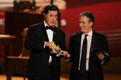 "Stephen Colbert and Jon Stewart at the Emmy Awards in Los Angeles in 2008. ""It is a very bad thing for the country that Comedy Central is the go-to place for hearing scientists talk about their recent work, but it's great for Comedy Central,"" says physicist Sean Carroll."