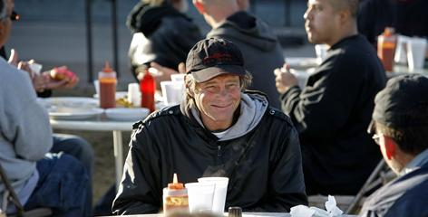 "Jeff Campbell, a homeless man, enjoys breakfast Feb. 13. ""Feeding the homeless and feeding those who are hungry has been recognized as an important religious belief for years,"" says Kevin Theriot, senior counsel for the Alliance Defense Fund."