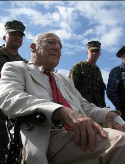 Veteran Richard Rothwell, 97, of Catonsville, Md., attends a memorial Wednesday on Iwo Jima, Japan. Dozens of U.S. veterans, now in their 80s and 90s, returned to the remote island to mark the 65th anniversary of one of World War II's fiercest battles.