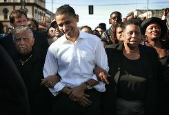 "Then-senator Barack Obama marches with a crowd to the Edmund Pettus Bridge on March 4, 2007, to commemorate the 1965 ""Bloody Sunday"" Voting Rights march in Selma, Ala. In the 1965 march, Alabama police beat back the marchers when they reached the Pettus Bridge."