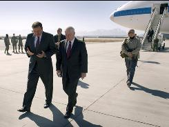 U.S. Secretary of Defense Robert Gates, right, talks with US Ambassador to Afghanistan Karl Eikenberry as he arrives in Kabul, Afghanistan on Monday. Gates made an unannounced visit, warning of &quot;hard fighting&quot; still ahead despite signs of progress in the eight-year war against Taliban insurgents.