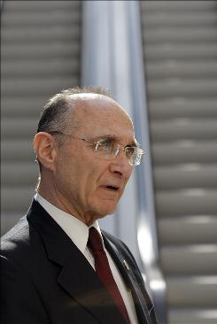 Israeli Infrastructure Minister Uzi Landau speaks to the news media during an international conference on civilian nuclear energy in Paris on Tuesday.