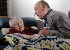 Neva Morris talks to her son-in-law Tom Wickersham at Northcrest Community on Oct. 20, in Ames, Iowa. Morris has become the oldest person in America.