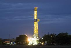 "A natural gas well operates at the Dallas/Fort Worth International Airport in Texas in May 2008. A study found that the operation of a saltwater injection disposal well used in the natural gas extraction process in the area was a ""plausible cause"" for a series of small earthquakes that occurred in the area between October 30, 2008, and May 16, 2009."