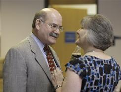 Don McLeroy, former Texas State Board of Education chairman, talks with new chairwoman Gail Lowe during a break in a meeting of the board where hearings on a new social studies curriculum were taking place.