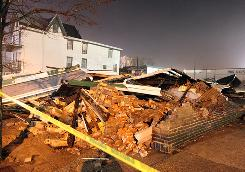A house on Artic Avenue in Atlantic City, lays flattened due to winds up to 60 mph from a nor' easter storm earlier Saturday.