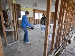 Youth Volunteer Corps of Greater Kansas City volunteer Maggie Wilcox, 14, left, and Tonya Lanz empty out a flood-damaged home in Oakville on Saturday.