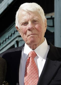 Peter Graves, seen here Oct. 30 2009, poses during dedication ceremonies for his star on the Hollywood Walk of Fame in L.A.. His movie career spanned classics such as Stalag 17 to comedies such as Airplane! but he is best remembered by many as the head of the Mission: Impossible force in the 1960s and 70s.