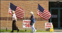 Voters leave the polling place March 2 at Riverwood Middle School in Kingwood, Texas. About 1.5 million Texans cast ballots in the Republican primary for governor.