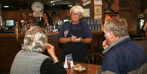 "Gold Dust Saloon owner Ruth McDonald, center, uses the ""three share"" model to provide health coverage for her workers in Pueblo, Colo."
