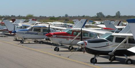Scores of confiscated planes sit on the airport tarmac in Culiacan, Mexico.  They will be auctioned or used by government.