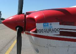 "A ""confiscated"" sign is slapped on drug runner's plane."