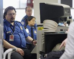 """Surveillance cameras and """"hands-free"""" conveyor belts, such as this one at Seattle-Tacoma International Airport on Jan. 4., has helped reduce the number of baggage theft and damage claims filed to the TSA."""